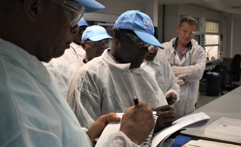 Study tour delegates take notes as they visit ALS Laboratories in North West England © United Nations Environment Programme / Denilson Mathew